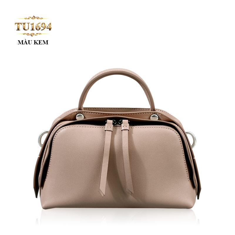 Túi xách đeo cao cấp form bầu dục khóa trên sành điệu TU1694 (Màu kem)